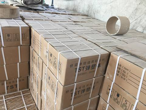 There are many cartons of asphaltic plug joint in the warehouse.