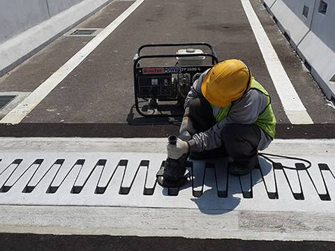 A worker is setting the finger expansion joints in the end of bridge.