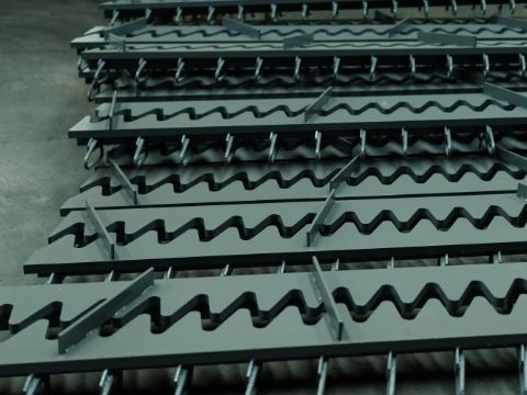 This is a finger expansion joint with sharp fingers.